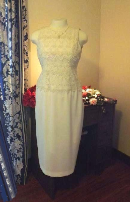 Sophisticated Tea Length Lace Dress with Open Back for rent - size 8