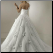 One Shoulder Satin and Organza Wedding Ballgown showing elegant back with satin button closure and satin rosettes on skirt and train