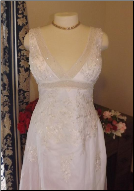 Beaded Wedding Gown with Lace-up Back and Shoulder Straps for rent - size 16
