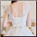 Chic Wedding Gown of Satin and Tulle - close up of elegant lace-up back