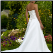 Elegant Strapless Satin Wedding Dress back view showing lace up back
