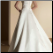 Elegant Strapless Satin Wedding Gown showing the back closure and train