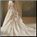 Graceful Embroidered Satin Wedding Gown showing the beautiful skirt and train