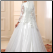 High Neck Long Sleeve Tulle Ballgown with Appliques showing back of gown