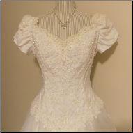 Elegant Off-the-Shoulder Bridal Gown for rent - size 14