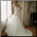 A Line Cap-Sleeve Tulle Wedding Gown - showing lace up back and train