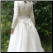Paloma Blanca Long Sleeved Lace Wedding Gown for rent - back of gown