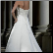 Elegant Strapless Satin Bridal Gown showing lace-up back and train