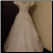 Off-the-Shoulder Bridal Ball Gown in stock size 14, back of gown shown bustled